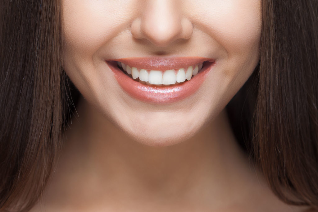 33908285 - beautiful woman smile. teeth whitening. dental care.